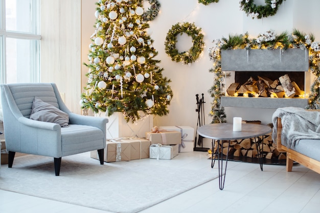 New year's interior, holiday, christmas, cozy and warm. christmas tree and fireplace
