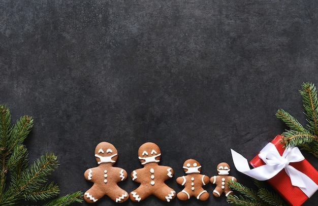 New year's layout with space for text. christmas background with gingerbread fir and gifts.