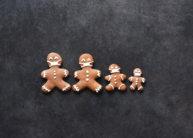 New year's layout with space for text. gingerbread family in masks.