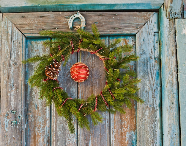New year's wreath of spruce and christmas decorations