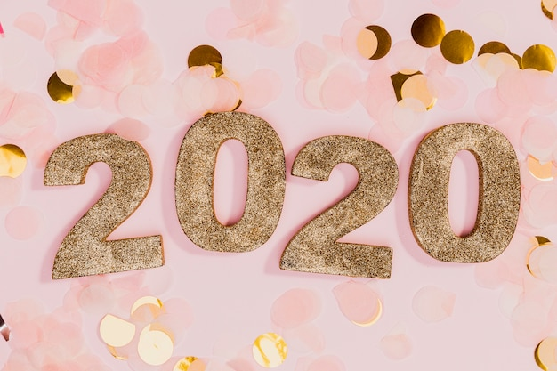 New year sign with gold and pink confetti