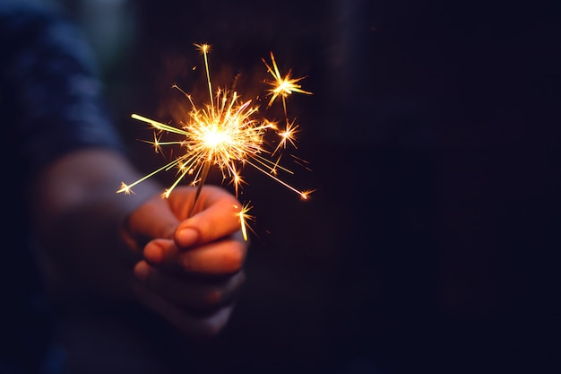 New year sparkler in woman hands.