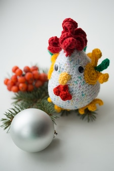 New year  symbol - handmade rooster with fir branches and cranberry