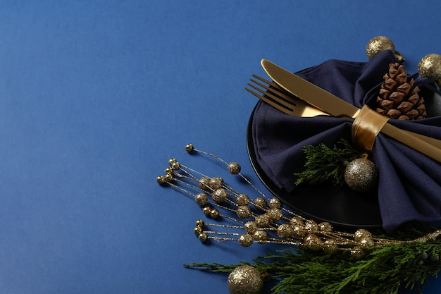 New year table setting on blue background.