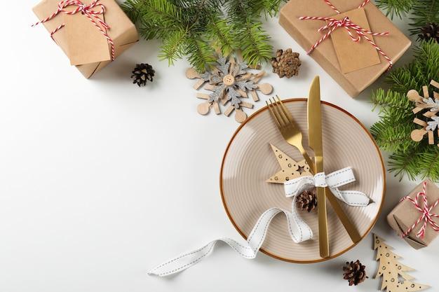 Сервировка новогоднего стола на белом фоне.