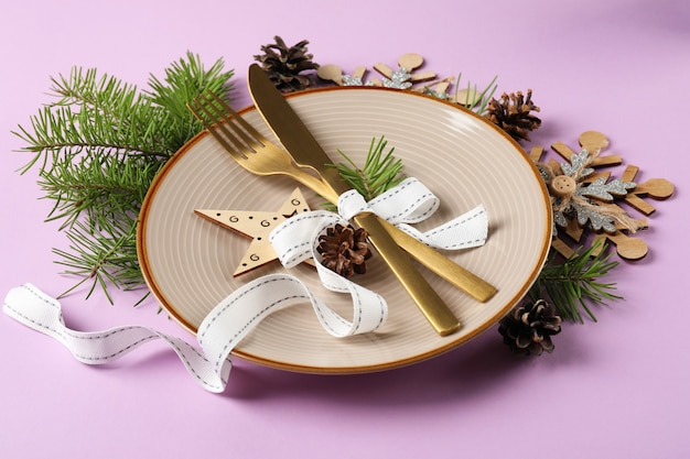 New year table setting on violet ã¢â€â‹background.