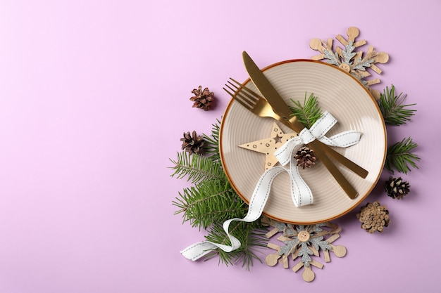 New year table setting on violet background.