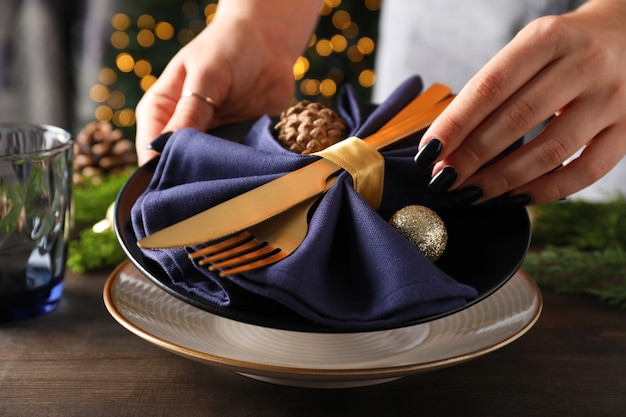 New year table setting with bokeh on wooden table.