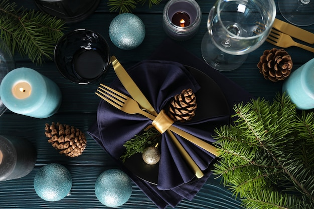 New year table setting on wooden table, top view.