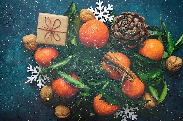 New years greeting card tangerines gift box cinnamon pine cones