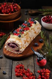 New years meringue roll with strawberries blueberries raspberries and cranberries