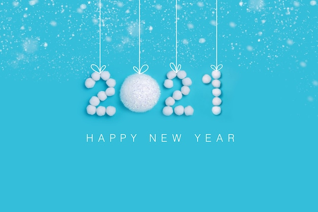 New years numbers made of white artificial snow on blue background