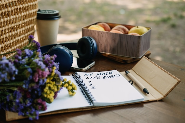 New years resolutions life goals list in open notebook on the table outdoor still life with my life