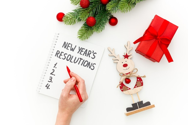 New years resolutions with christmas decorations isolated