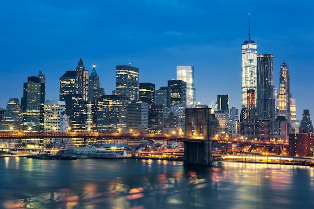 New york city manhattan midtown at dusk with brooklyn bridge. usa.