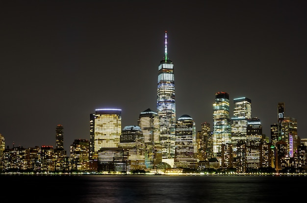 New york city manhattan ny skyline panorama at night over hudson river with reflections viewed from new jersey usa