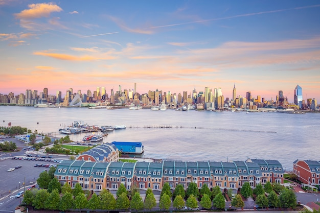 New york city midtown manhattan sunset skyline panorama view over hudson river in usa