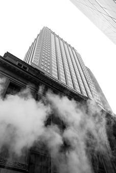 New york, usa - may 03, 2016: manhattan street scene. cloud of vapor from the subway on the streets of manhattan in nyc. typical view of manhattan