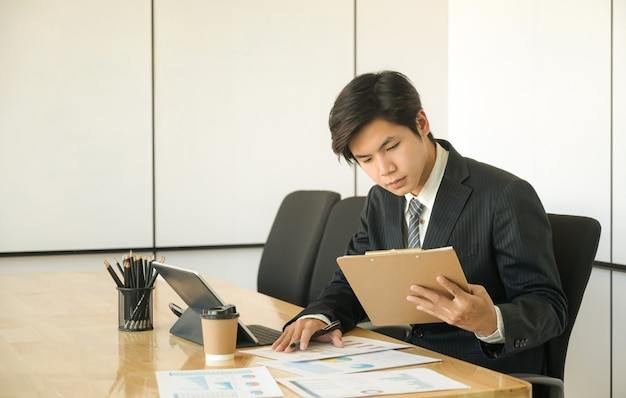 New young executives are reviewing the organization performance report.