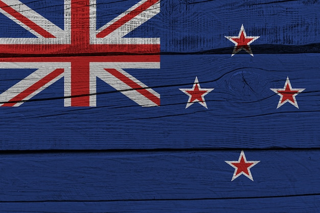 New zealand flag painted on old wood plank