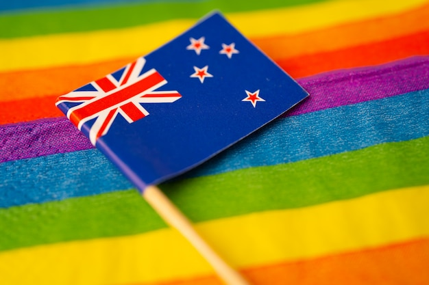 New zealand flag on rainbow symbol of lgbt gay pride month.