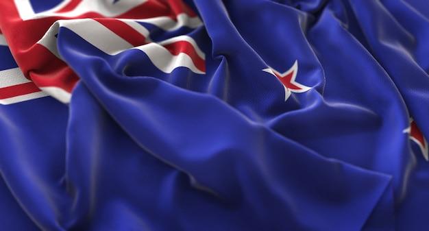 New zealand flag ruffled beautifully waving macro close-up shot