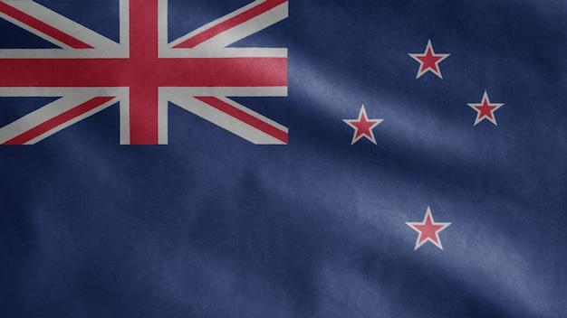 風に揺れるニュージーランドの旗。ニュージーランドのテンプレートを吹く、柔らかく滑らかなシルクのクローズアップ。