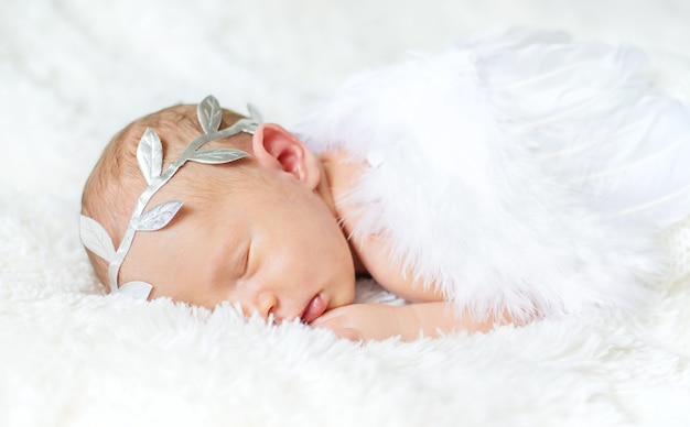Newborn angel photo session in a suit. selective focus. people.