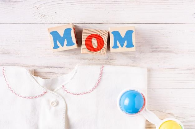 Newborn baby accessories on white wooden background