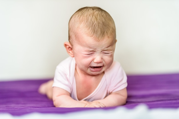 Newborn baby angry and crying without comfort.