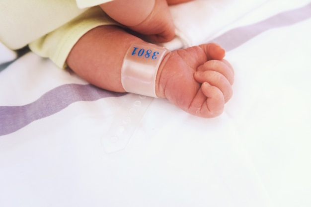 Newborn baby first days of life in delivery room infant asleep in hospital after childbirth