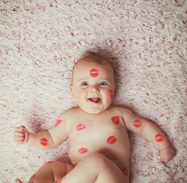 Newborn baby gir filled kisses