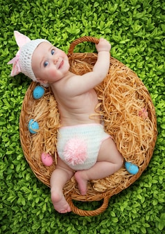 Newborn baby girl dressed as easter bunny