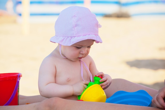 Newborn baby girl at the sea