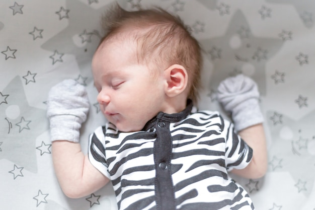 A newborn baby sleeping