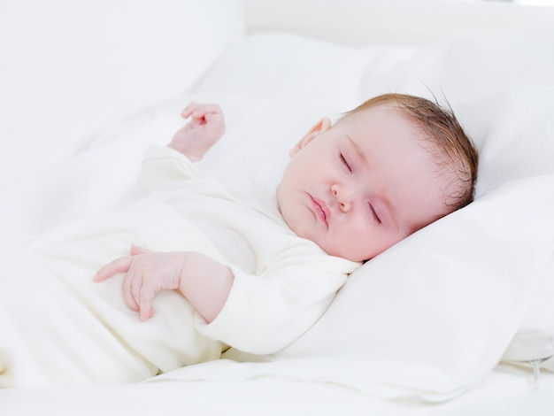 Newborn baby in sweet dreams