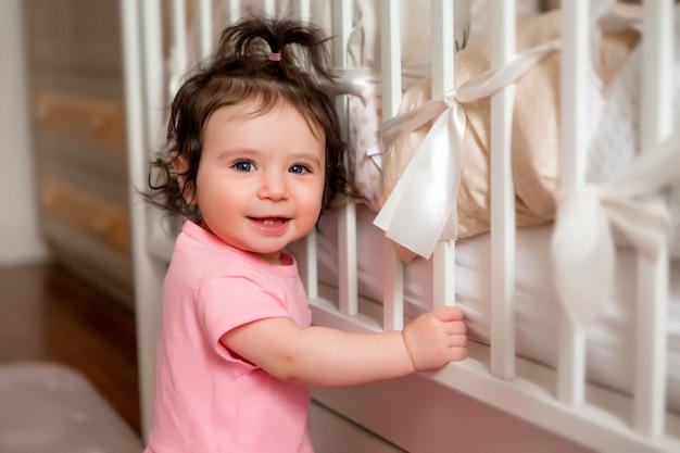 Newborn baby toddler girl in baby bed