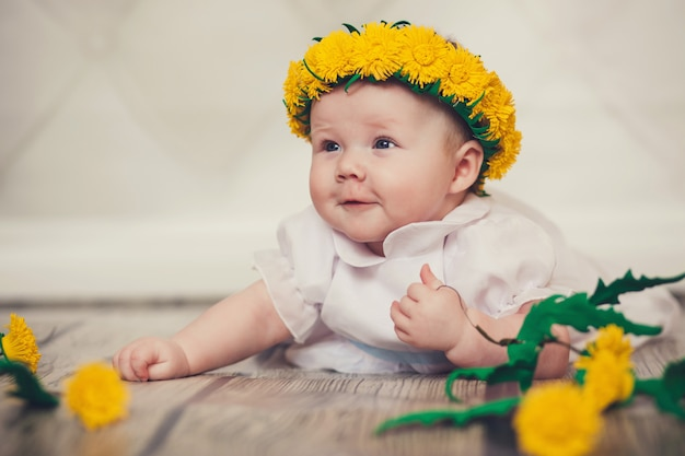 Newborn baby with a wreath