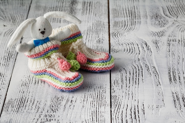 Newborn booties for christening or birthday invitation announcement