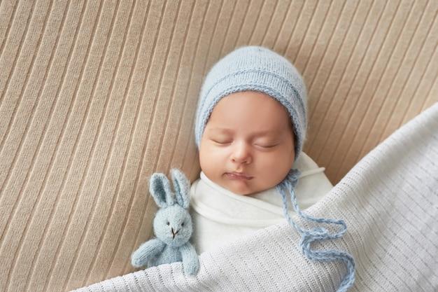 Newborn boy on white background