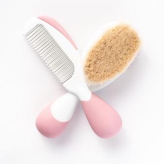 Newborn brush and comb isolated on white.