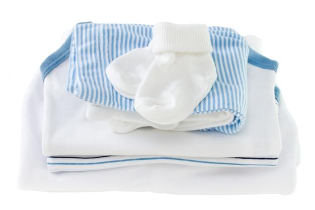 Newborn clothes on white background