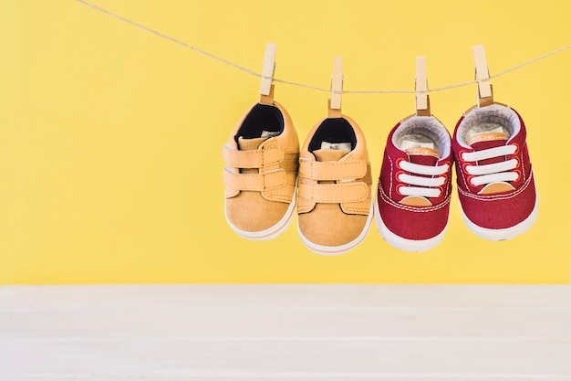 Newborn concept with two shoes on clothesline