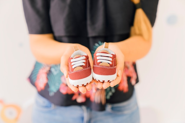 Newborn concept with woman showing shoes