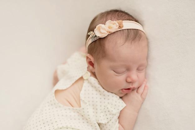 Newborn girl on a light background