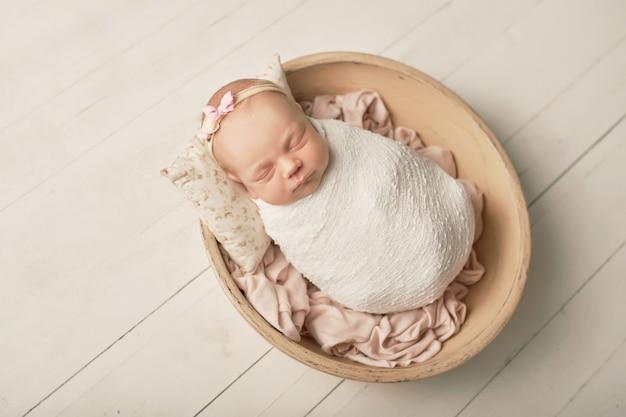 Newborn girl on a white background