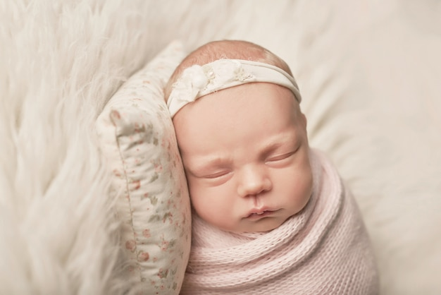 Newborn girl on a white