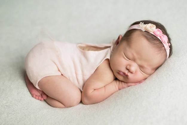 Newborn girl on a white
