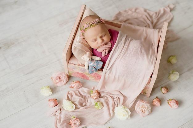 Newborn girl on white