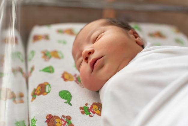 Newborn in a hospital bad  wrapped in a diaper maternity hospital number 5 krasnodar russia dec